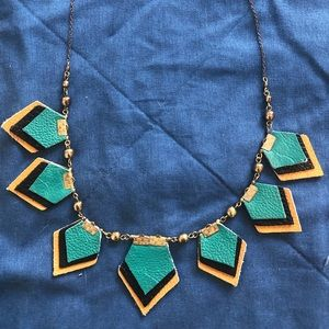 Necklace with teal leather pieces